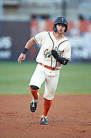 Brett Kinneman (27) of the Greensboro Grasshoppers hustles towards third base against the Hagerstown Suns at First National Bank Field on April 6, 2019 in Greensboro, North Carolina. The Suns defeated the Grasshoppers 6-5. (Brian Westerholt/Four Seam Images)