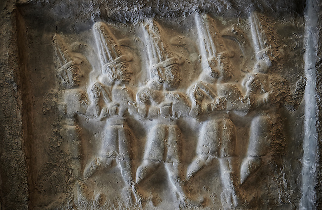Sculpture of the twelve gods of the underworld from the 13th century BC Hittite religious rock carvings of Yazılıkaya Hittite rock sanctuary, chamber B, Hattusa, Bogazale, Turkey. Plastercast at the Vorderasiatisches Museum, Pergamon Museum, Berlin.