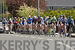 The cyclists pass through Currow village during he Johnny Drum classic in Currow on Sunday