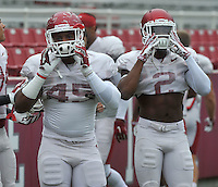 NWA Democrat-Gazette/MICHAEL WOODS &bull; @NWAMICHAELW<br /> University of Arkansas defensive back's Josh Harris (45) and DJ Dean (2) runs drills during practice Saturday August 22, 2015 at Razorback Stadium in Fayetteville.