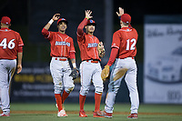 Lucas Williams (12) of the Lakewood BlueClaws celebrates with teammates Arquimedes Gamboa (center) and Daniel Brito following their win over the Kannapolis Intimidators at Kannapolis Intimidators Stadium on April 6, 2017 in Kannapolis, North Carolina.  The BlueClaws defeated the Intimidators 7-5.  (Brian Westerholt/Four Seam Images)