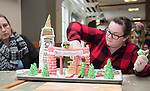 Amanda Mansfield, puts the finishing touches on The Office of Global Opportunity's gingerbread house. Photo by Ben Siegel