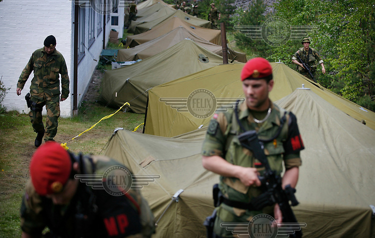 Norwegian Home Guard soldiers has set up camp behind a local government building during exercise Djerv..The Home Guard has traditionally been designated to secure important  domestic installations in case of war or crisis. With the cold war long gone, a war in Afghanistan and budget cuts, there is a debate over the Home Guard's role in the future.