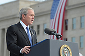 Arlington, VA - September 11, 2008 -- United States President George W. Bush speaks at the Pentagon Memorial dedication ceremony Sept. 11, 2008. The national memorial is the first to be dedicated to those killed at the Pentagon on Sept. 11, 2001. The site contains 184 inscribed memorial units honoring the 59 people aboard American Airlines Flight 77 and the 125 in the building who lost their lives that day. .Credit: Cherie Cullen - DoD via CNP
