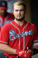 Catcher Shea Langeliers (4), an Atlanta Braves' First-Round pick (9th overall) out of Baylor in the 2019 MLB Draft, now with the Rome Braves, stands in the dugout before a game against the Greenville Drive on Thursday, June 27, 2019, at Fluor Field at the West End in Greenville, South Carolina. Rome won, 4-3. (Tom Priddy/Four Seam Images)