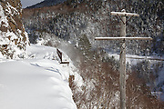 Crawford Notch State Park - Old telephone pole along the Maine Central Railroad in Hart's Location, New Hampshire during the winter months. Dismal Pool is located down the steep embankment on the right.