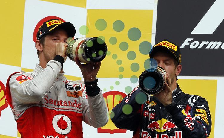 Formel 1 2011,11.Lauf Spa-Francorchamps,26.08.-28.08.11 .Jenson Button (GBR#4) Vodafone McLaren Mercedes, Sebastian Vettel (GER#1) Red Bull Racing..Picture:Hasan Bratic/Universal News And Sport (Europe) 28/08/2011.