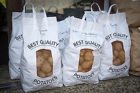 Bagged potates for sale at a farm shop - Norfolk