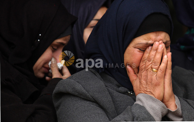 Relatives of Palestinian Rahiq Birawi, who according to the Israeli police was shot dead after she had advanced towards them with a knife in her hand at a checkpoint last October, mourn during her funeral after Israel released her body, in the West Bank village of Aseera Ashamaliya near Nablus December 17, 2016. Photo by Nedal Eshtayah