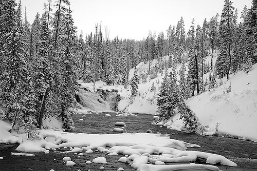 LEWIS FALLS IN WINTER ALONG THE LEWIS RIVER IN YELLOWSTONE NATIONAL PARK,WYOMING