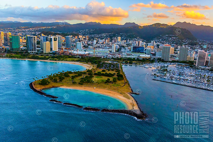 A bird's eye view during a morning helicopter tour of Magic Island, with Ala Moana Beach Park on the left and Ala Wai Boat/Yacht Harbor on the right, Honolulu, O'ahu.