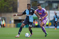Gozie Ugwu of Wycombe Wanderers  takes on Curtis Nelson of Plymouth Argyle during the Sky Bet League 2 match between Wycombe Wanderers and Plymouth Argyle at Adams Park, High Wycombe, England on 12 September 2015. Photo by Andy Rowland.