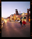 USA, Utah, Park City, a couple crossing the street in downtown Park City at night