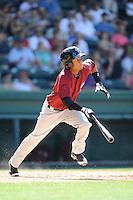 Shortstop Yeixon Ruiz (5) of the Savannah Sand Gnats bats in a game against the Greenville Drive on Sunday, June 22, 2014, at Fluor Field at the West End in Greenville, South Carolina. Greenville won, 7-3. (Tom Priddy/Four Seam Images)