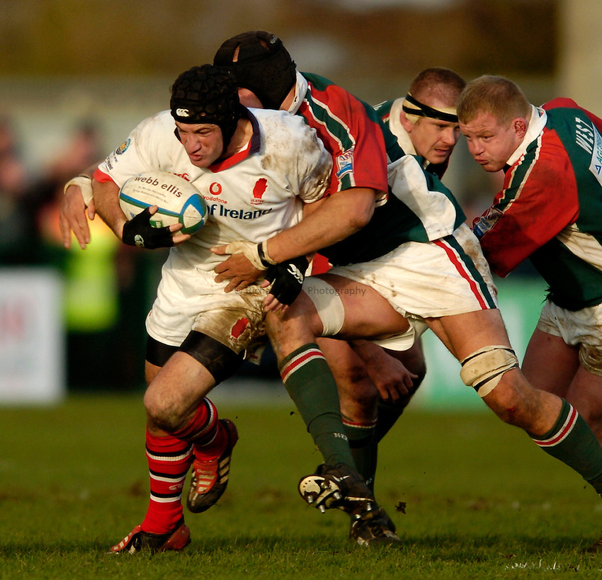 Photo: Richard Lane..Ulster Rugby v Leicester Tigers. Heinenken Cup. 11/01/2004..David Humphreys breaks through the Leicester forwards.