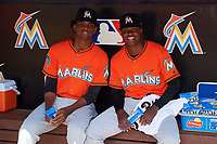 Miami Marlins Edward Cabrera (68) and George Soriano (98) in the dugout before a Florida Instructional League game against the Washington Nationals on September 26, 2018 at the Marlins Park in Miami, Florida.  (Mike Janes/Four Seam Images)