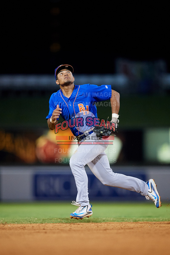 Midland RockHounds shortstop Richie Martin (12) tracks a pop up during a game against the Arkansas Travelers on May 25, 2017 at Dickey-Stephens Park in Little Rock, Arkansas.  Midland defeated Arkansas 8-1.  (Mike Janes/Four Seam Images)