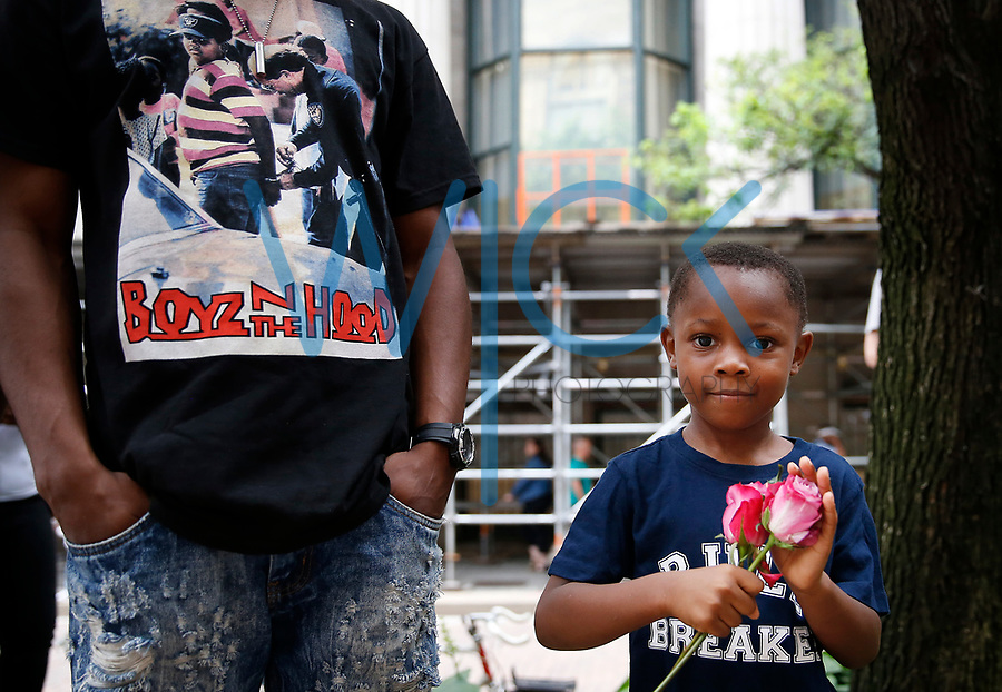 Jamel McCray (left) and his step-son, ReShawn Todd, 4, attend a rally for Antwon Rose, the 17-year old who was shot and killed by East Pittsburgh police. (Photo by Jared Wickerham/For Pittsburgh Current)