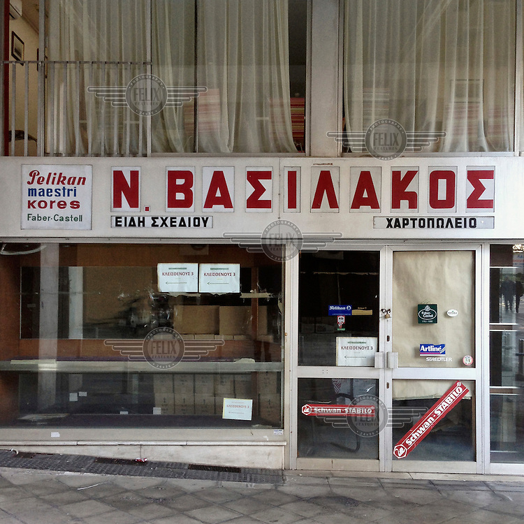 A closed down stationary shop on Kleisthenous Street. The sign in the window says that the shop has moved nearby.