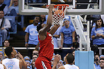 24 February 2015: NC State's BeeJay Anya dunks the ball. The University of North Carolina Tar Heels played the North Carolina State University Wolfpack in an NCAA Division I Men's basketball game at the Dean E. Smith Center in Chapel Hill, North Carolina. NC State won the game 58-46.