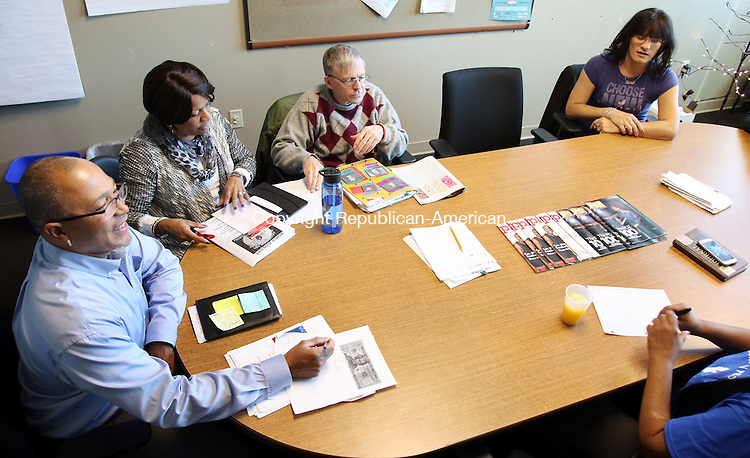 WATERBURY CT. 23 November 2015-112315SV07-Sam Bowens III and Joyce Boone both of the Health Department, at left,  run a meeting to organize a World AIDS Day on December 1st in Waterbury Monday. Waterbury will celebrate it with a candlelight vigil and awards ceremony at Grace Baptist Church at 6 p.m on the 1st.<br /> Steven Valenti Republican-American