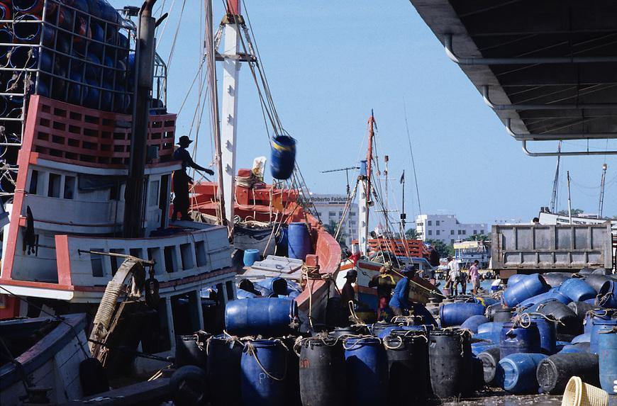 Fisherman unloading  captured fish from fishing boat