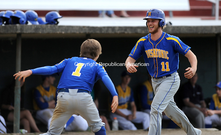 WINSTED, CT-20 APRIL 2012--042012JS15--Housatonic's Jacob Folley (11) is greeted at home plate by teammate Willia Yahn after blasting a two-run home run in the seventh inning of their game against Gilbert Friday at Walker Field in Winsted. The home run was not enough as the Mountaineers fell to the Yellowjackets 6-5.Jim Shannon Republican-American