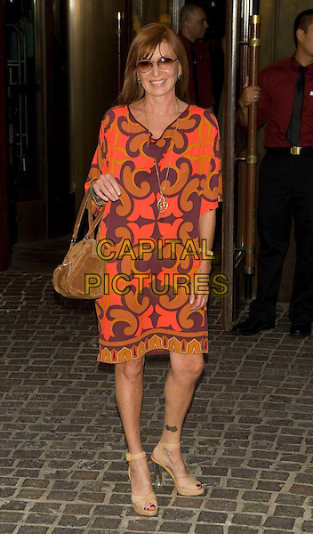 "NICOLE MILLER .New York screening of ""Elegy"".at the Tribeca Grand Hotel, New York, NY, USA, August 5, 2008..full length orange print dress brown bag beige tan sunglasses .CAP/LNC/TOM.©LNC/Capital Pictures"