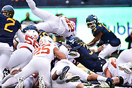 Morgantown, WV - NOV 18, 2017: Texas Longhorns running back Daniel Young (32) leaps over the pile for the game winning touchdown during game between West Virginia and Texas at Mountaineer Field at Milan Puskar Stadium Morgantown, West Virginia. (Photo by Phil Peters/Media Images International)