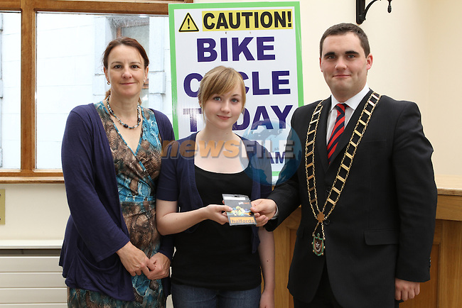 Mayor Kevin Callan presents Maedhbh Honan with her Prize for the Bike Week Art Competition. Pictured here with her mother Sue...(Photo credit should read Jenny Matthews www.newsfile.ie)....This Picture has been sent you under the conditions enclosed by:.Newsfile Ltd..The Studio,.Millmount Abbey,.Drogheda,.Co Meath..Ireland..Tel: +353(0)41-9871240.Fax: +353(0)41-9871260.GSM: +353(0)86-2500958.email: pictures@newsfile.ie.www.newsfile.ie.