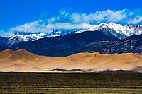 Home to the tallest sand dunes in North America, Great Sand Dunes National Park sits at the base of the Sangre de Cristo Mountain Range in Colorado. The dunes were formed over thousands of years from sand in ancient lake beds in the San Luis Valley and unique wind patterns.
