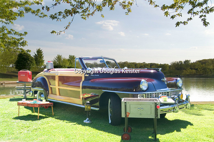 The woody is a truly an iconic American vehicle. This predecessor of today&rsquo;s SUV conjures up images of fun and recreation, especially when a couple of surfboards are strapped on top. But the woody&rsquo;s roots are more utilitarian, as the first production models that appeared in the 1930s were service vehicles that had wood bodies mounted on truck frames. Many of them were used by resorts to transport guests and their luggage back and forth between the resort and the train station. Hence the name, station wagon. <br /><br />The real boom in woodies happened immediately after World War II when raw materials to manufacture motor vehicles were in short supply&mdash;that is, most materials except wood. Motor vehicle manufacturers were also required by the government to keep the prices of vehicles at their prewar levels, unless they had a new body. Thus the woody body style was adopted by the big three automakers, General Motors, Ford and Chrysler, so they could sell them at whatever price the market would bear. These versatile vehicles found a ready market among the newly minted post-war families. In addition to transporting the children and groceries, they became a recreation and camping vehicle, much like the auto camps of the early twentieth century. As raw materials became more readily available, auto manufacturers switched to steel bodies and the resale value of woodies plummeted. Because of their low prices and their ability to hold lots of cargo, they became the vehicle of choice for the beach crowd. Nowadays, expertly restored woodies can command prices well over $100,000. Brad Boyajian owns this award-winning 1946 Chrysler Town and Country convertible woody. Photographed in Chatsworth, California.