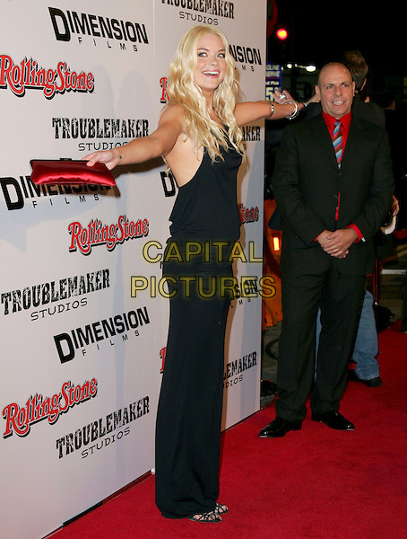 "JAMIE KING.attends Dimension Films' World Premiere of ""Sin City"" held at The Mann National Theater in Westwood, California on March 28th 2005..full length james black red clutch bag purse arms out.Ref: DVS.www.capitalpictures.com.sales@capitalpictures.com.©Debbie VanStory/Capital Pictures"