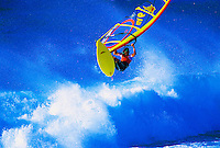 Windsurfer in flight at Hookipa Beach Park, Maui