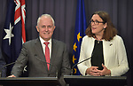 Malcolm Turnbull, Australian Prime Minister (L) speaks with Cecilia Malmstrom, Trade Commissioner of the European Union (R),  during a press conference at Parliament House, Canberra, Monday, June 18, 2018.