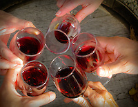 Gift card photo (set of 4) of Friends toasting wine glasses over a wine barrel