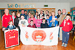 Nano Nagle Presentation: Friend of Nano Nagle School, Listowel Frank Greaney  and members of the Liverpool supporters club presenting  a cheque for €2100.00 to Bridie Murphy , principal Nano Nagle, the proceeds of a raffle for a signed Liverpool jersey which was won by Sarah Cox and presented to her by Declan Carty, Listowel Liverpool supporters club.
