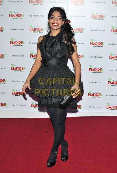 AMARA KARAN.At the Empire Film Awards,.Grosvenor House Hotel, London, England, March 9th 2008..full length black dress clutch bag tights.CAP/PL.©Phil Loftus/Capital Pictures