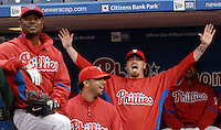 Philadelphia Phillies pitcher Tom Gordon, left, pitcher J. C. Romero, center, and pitcher Brett Myers, right, react as they watch a 2007 season's high light video before taking the field for batting practice prior to the MLB exhibition game against the Toronto Blue Jays Friday, March 28, 2008, in Philadelphia. (AP Photo/Bradley C Bower)