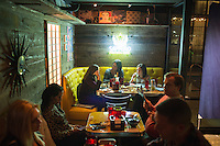 People eat at Hojoko, a Japanese bar and restaurant in The Verb Hotel in the Fenway neighborhood of Boston, Massachusetts, USA, on Friday, Dec. 4, 2015.