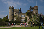 Malahide Castle is a Norman structure in north county Dublin, Ireland. et on 250 acres of park land in the pretty seaside town of Malahide, was both a fortress and a private home for nearly eight hundred years. The Talbot family lived here from 1185 to 1973, when the last Lord Talbot died.....The house is furnished with beautiful period furniture together with an extensive collection of Irish portrait paintings, mainly from the National Gallery. The history of the Talbot family is recorded in the Great Hall, with portraits of generations of the family telling their own story of Ireland's stormy history. One of the more poignant legends concerns the morning of the Battle of the Boyne in 1690, when fourteen members of the family breakfasted together in this room, never to return, as all were dead by nightfall. ....The castle is open to the public...