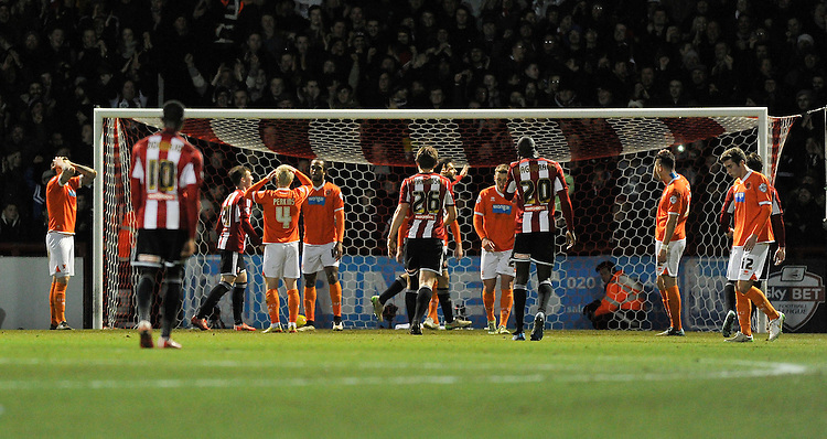 Blackpool players dejected after conceding the 4th goal to Brentford<br /> <br /> Photographer Ashley Western/CameraSport<br /> <br /> Football - The Football League Sky Bet League One - Brentford v Blackpool - Tuesday 24th February 2015 - Griffin Park - London<br /> <br /> &copy; CameraSport - 43 Linden Ave. Countesthorpe. Leicester. England. LE8 5PG - Tel: +44 (0) 116 277 4147 - admin@camerasport.com - www.camerasport.com