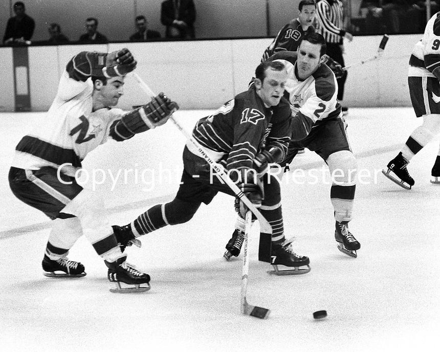 Seals vs North Stars (1969 photo) Norm Ferguson, North Stars #11 J.P.Parise, and #2 Larry Hillman (Ron Riesterer/Photo)