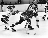 Seals vs North Stars (1969 photo) Norm Ferguson, North Stars #11 J.P.Parise, and #2 Larry Hillman (Ron Riesterer/Photo)