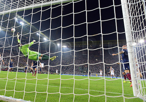 07.09.2014. Dortmund, Germany.   international match Germany Scotland  in Signal Iduna Park in Dortmund. David Marshall Scotland with a dispairing dive to try to save the headed goal from Thomas Mueller Germany