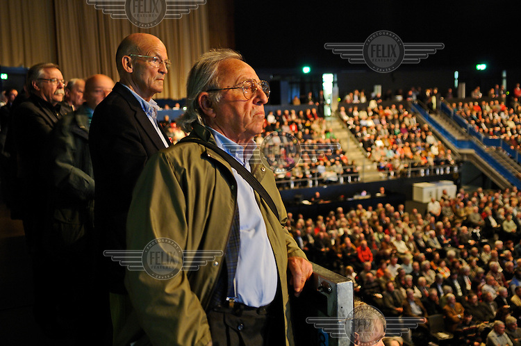 Shareholders attend the annual general meeting of UBS, Switzerland's largest bank, at a concert stadium in Basel. The Swiss banking industry holds an estimated 4,000 billion Swiss Francs (USD 4,240 billion) in assets, more than half of it foreign, including CHF 880 billion in undeclared European assets alone, benefiting from the country's famous banking secrecy laws.