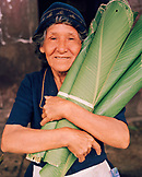 PERU, Belen, South America, Latin America, senior woman holding banana leaves that she is selling at the Belen Market.