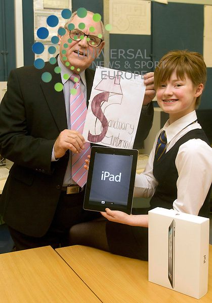 2nd year pupil Amy McMonagle of Greenfaulds high school who one an ipad in the Sanctuary Cumbernauld's logo competition and Alex Clark Chair Cumbernauld Housing..Picture: Maurice McDonald/Universal News And Sport (Scotland). 8 February 2012. www.unpixs.com.