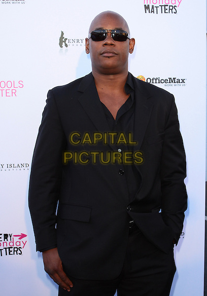 "BOKEEM WOODBINE .The Every Monday Matters Foundation presents ""1st Annual Party with a Purpose"" to launch the Our Schools Matter  held at  Smashbox Studios, West Hollywood, California, USA..May 3rd, 2010.half length black jacket sunglasses shades   .CAP/ADM/TC.©T. Conrad/AdMedia/Capital Pictures."