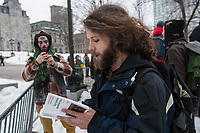 A protester reads poetry to a policemen during a protest against austerity organized by the ASSE student group in Quebec city Thursday March 26, 2015.<br /> <br /> PHOTO :  Francis Vachon - Agence Quebec Presse